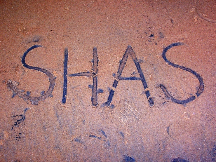 His name in sand..